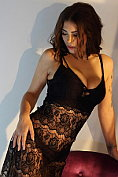 April shows off in her black see-through dress and knickers