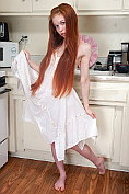 Dolly Little teases before showing herself off in the kitchen