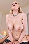 Busty blonde Angel Wicky gives a full-service masage