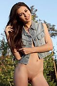Mila strips naked in the countryside