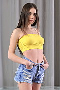 Katie teases as she takes off her top, denim shorts, and then her knickers