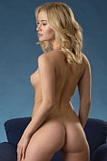 Curvaceous blonde babe Gabi posing naked on a chair