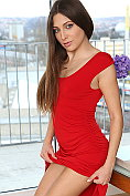 Talia Mint is not wearing anything under her sexy red dress