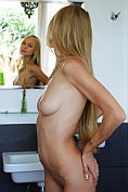 Nancy A poses naked in the bedroom