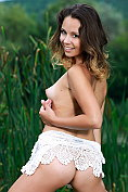 Sexy teen Alma gets naked in the tall grass