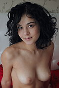 Busty cutie Callista B poses naked on the bed