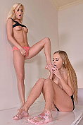 Candee Licious and Katarina Muti indulge in some girl on girl foot play