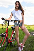 Slim teen Cheyanna shows off on her bicycle