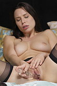 Aidra Fox leaves on her seamed stockings and suspenders while she masturbates