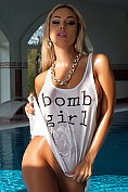 Blonde superbabe Maria takes off her wet t-shirt