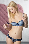 Flawless blonde Amaris takes off her bra and knickers and lays back with her legs apart