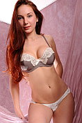 Ledona takes off her bra and knickers