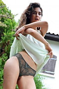 Charlotta strips naked in the garden