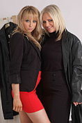 Elle Parker helps another blonde choose a leather coat