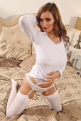 Busty babe Sammy Braddy strips down to her knickers, suspenders and stockings