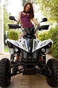 Alice May poses naked for us on the quad bike