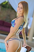 Beautiful blonde teen Aida strips naked by the pool