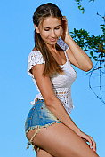 Milenia strips naked by the lake