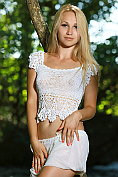 Belonika takes off her shorts and her crop-top in the woods