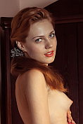 Shirley Tate takes off her dress and poses naked for us on the sofa