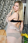 Gorgeous blonde Amaly does a seductive striptease for us