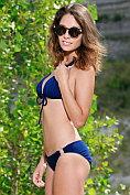 Wonderful teen babe Emmy takes off her bikini for us