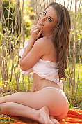Jess Impiazzi strips down to her knickers in the long grass
