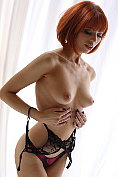 Fabulous redhead Amy showing off her sexiest lingerie