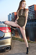 Milla Azul shows herself off down by the car