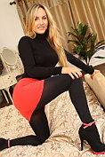 Natasha Anastasia shows off on the bed in her black opaque tights