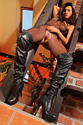 Michaela makes an exhibition of herself in crotchless fishnet lingerie and leather boots