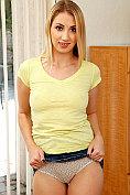 Blonde hottie Sierra Nicole undresses and poses naked in her bedroom