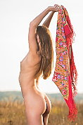 Mary Kalisy poses naked in the open air