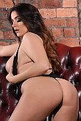 Buxom babe Jessika Jinx teasing in her flimsy black lingerie