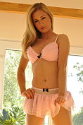 Sam Tye takes off her pretty pink lingerie for us