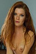 Seductive redhead Mia Sollis