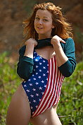 Elen Moore posing in her stars and stripes swimsuit