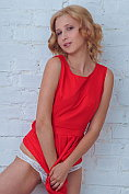 Pretty petite blonde Milana Bene takes off her summer dress and knickers