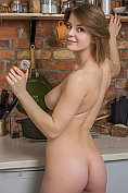 Buxom babe Yelena takes off her top and her jeans in the kitchen
