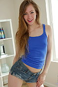 Cute teen Emma Scarlett takes off her sexy casual outfit to show herself off to you
