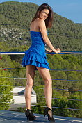 Candice Luka takes off her little blue dress and poses naked on the balcony