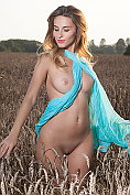 Rena takes off her already revealing dress on a walk in the fields
