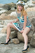 Blonde teen Runa shows off and strips naked at the seaside