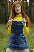 Jia Lissa takes off her dungaree dress and then her jumper leaving herself naked on the picnic rug