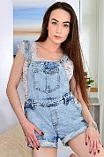 Angel Rush teases in her denim dungarees