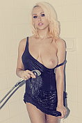 Busty blonde babe Sabrina gets her dress all soaking wet in the shower