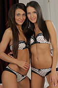 Two gorgeous girls make out in their identical matching lingerie