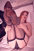 Sexy redhead Zara Du Rose teases with her stockings and suspenders