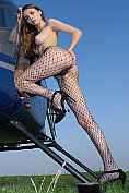 Milla undresses by the helicopter