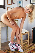Beautiful blonde Cayla strips naked for us